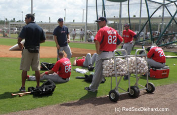 The players take a break at the end of practice.