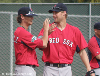 Clay Buchholz and Daniel Bard share a high-five and a laugh after one of their drills.
