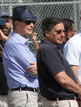 John Henry and Tom Werner watch batting practice.