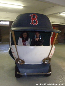 My friend and I got to sit in the bullpen cart that used to drive pitchers in from the 'pen. If he's the one behind the wheel, that must make me the one who's coming in to pitch!