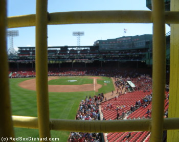 Looking through the left field foul pole at the park, from the top of the Green Monster. All day I continued to be surprised how many people were there.