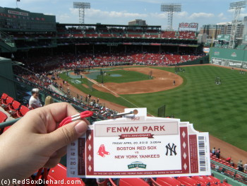 "My commemorative ticket with the view from my ""seat"" in the standing room area behind the right field roof boxes."