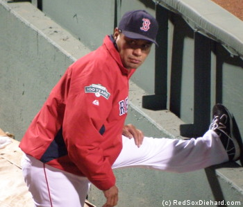 Vicente Padilla stretches in the bullpen before coming in to pitch a 1-2-3 eighth inning.