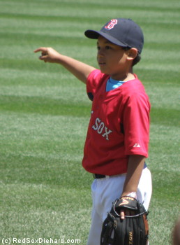 Ortiz calls his shot: Little Papi points out where he wants his Dad to throw it so he can make a diving catch.