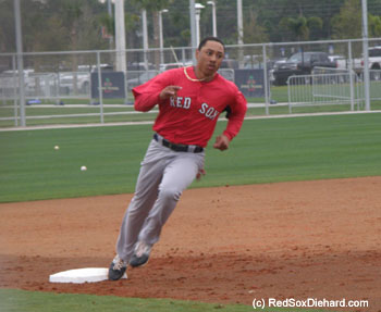 2011 draftee Mookie Betts rounds third base in a baserunning drill.
