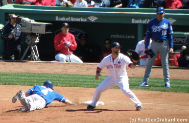 Mike Napoli awaits the throw as Alex Gordon dives back to the bag.