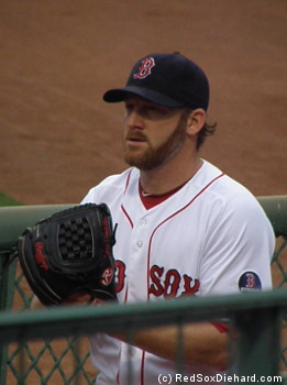 Ryan Dempster warms up before the game.