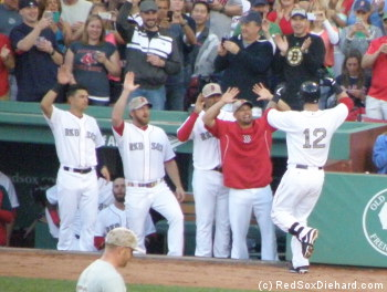 Mike Napoli is congratulated by his teammates after his first-inning home run.