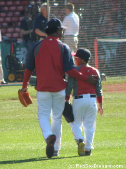 Pedro Martinez and his son walk in after batting practice.  With Shane Victorino on the D.L., either one of them would be welcome to suit up and play right field.