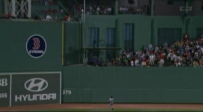 You can see me on TV when Stephen Drew's controversial hit went out to center field.  I'm in the white jcket with my arms in the air, right next to the camera well, a couple of row back. The ball landed just to the blue-shirted camera guy's right.