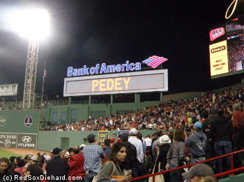 Dustin Pedroia is feted on the scoreboard after a huge, game-tying home run.