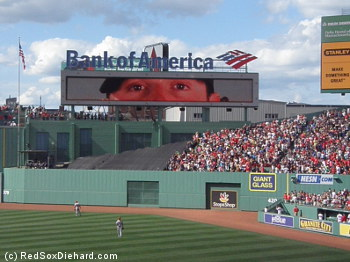 A giant Jarrod Saltalamacchia watches over the bleacher section where both his home runs landed.