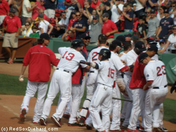 Shane Victorino is congratulated by his teammates for delivering the winning blow.