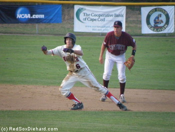 Aaron Barbosa breaks for third while shortstop Drew Jackson watches on.