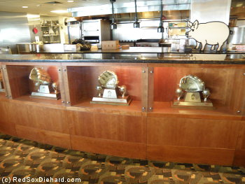Gold Gloves won by the Red Sox are on display in the EMC Club, inside the counters in front of the kitchen.