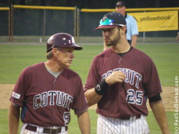 Cotuit manager Mike Roberts talks to first baseman Yale Rosen in front of the dugout.