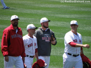 """Andrew Miller, Craig Breslow, Alex Wilson, and Andrew Bailey walk out to the bullpen before the game wearing their """"special"""" holiday hats.  The latter three would all end up pitching a scoreless inning in the game."""