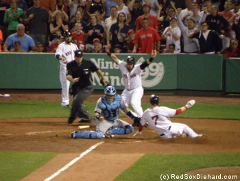 Stephen Drew slides in safely (according to Jonny Gomes and, eventually, the umpire) with a huge insurance run.