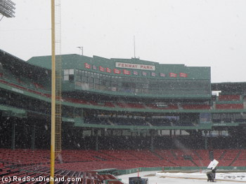 Snow was falling in Fenway Park as an ice rink was being constructed.