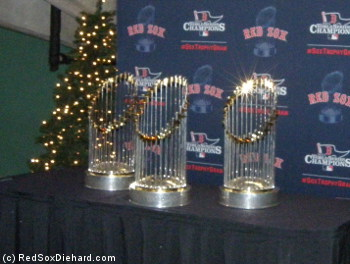 The World Series trophies from 2004, 2007, and 2013 were on display in the concourse.