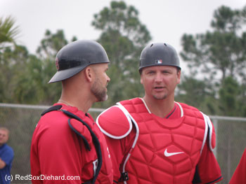 Catchers David Ross and A.J. Pierzynski confer during practice.