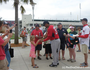Felix Doubront was walking down the sidewalk right among the fans, when he stopped to sign autographs for a polite and appreciative crowd.