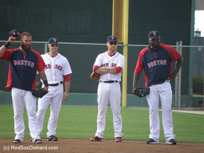 Four first basemen during infield practice - Mike Napoli, Daniel Nava, Mike Carp, and David Ortiz.