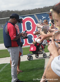 Fans - and even a dog in a stroller - wait for Pedro's autograph.