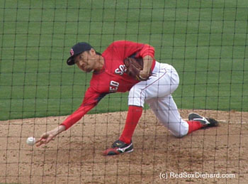 Submarine pitcher Shunsuke Watanabe delivers a pitch during his 1-2-3 inning of relief.