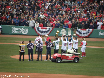 Mark Recchi of the Bruins; Ty Law, Troy Brown, and Tedy Bruschi of the Patriots; Leon Powe of the Celtics; and Jason Varitek, Pedro Martinez, and Mike Lowell of the Red Sox hoist their hardware. Outgoing Mayor Tom Menino handed the ball off to new Boston Mayor Marty Walsh, who threw out the first pitch.