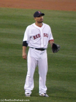 Shane Victorino doubled and scored a run in his 2014 debut.