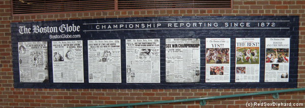 This mural showing the front page of the Boston Globe the day after each world Series win is new this year.