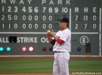 Junichi Tazawa pauses on the mound, while the scoreboard behind him tells the sad tale of the game.