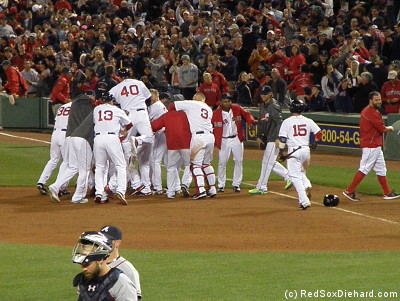 Xander Bogaerts is congratulated by his teammates (he's in there somewhere) after sparking the game-winning play.