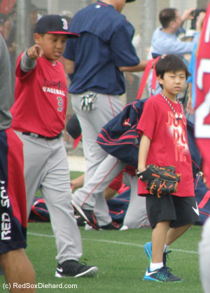 Big Papi's son D'Angelo and Koji Uehara's son Kaz joined the team as they stretched out before practice. D'Angelo stuck around and shagged flies with the other players while Papi took batting practice..