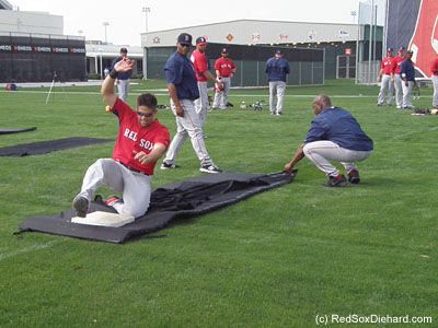 One of the silliest drills, and therefore my favorite, is when they practice sliding. Here, Garin Cecchini takes his turn on the mat. Players have to change out of their cleats and into sneakers, and then change back afterward.