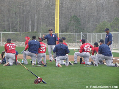 As the players finished batting practiced, they joined first base coach Arnie Beyeler for some more instruction.