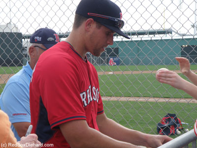 Garin Cecchini, the third base prospect who made his major league debut last year, signed autographs after practice.