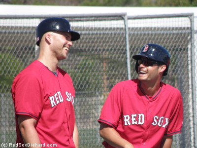 Justin Masterson and Joe Kelly share a laugh while waiting for their turns  in a bunting drill.