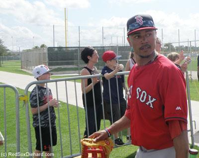 Mookie Betts walks between fields to get to batting practice.