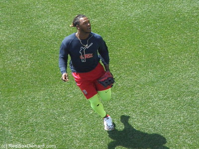 Hanley Ramirez takes fielding practice in front of the Green Monster.