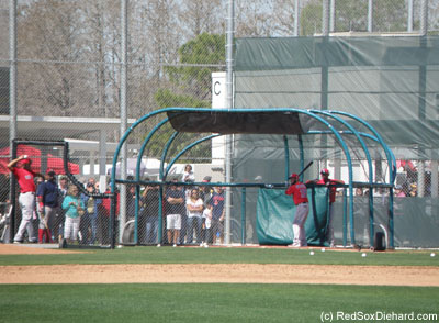 A large crowd watches as Dustin Pedroia takes some swings during batting practice.
