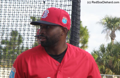 Jackie Bradley Jr. smiles after finishing a round of B.P.