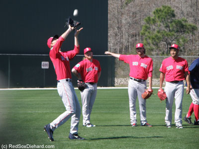 Henry Owens makes the catch as the picthers participate in a popup drill.