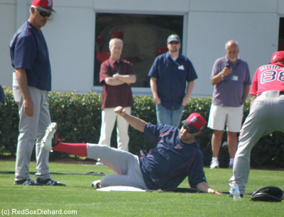 Next it was time for my former favorite drill, sliding on sheets of black pastic that look like a Slip'n Slide. Here's David Murphy sliding in under the watchful eye of Dwight Evans. Murphy had been drafted by the Red Sox in 2003, made his debut in Boston in 2006, and then was traded to the Texas Rangers as part of the deal for Eric Gagne at the trade deadline in '07.  Since then he's played with the Rangers, Indians, and Angels, and he just signed back on with the Red Sox yesterday.