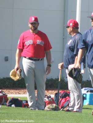 That's right, I said Jason Varitek. The former Captain was there working with the catchers.  And he had his glove with him wherever he went, ready to go if needed.  Here, he talks with Pawtuket hitting coach and fellow former catcher, Rich Gedman.