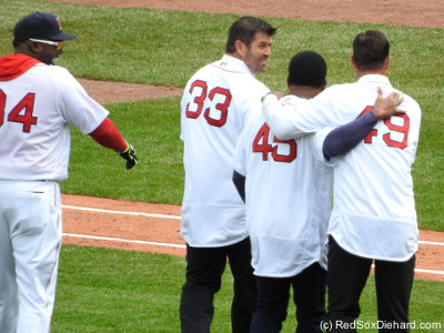 "David Ortiz, Jason Varitek, Pedro Martinez, and Tim Wakefield came out to say ""Play ball"" and kick off the game. (Technically Tek covered Pedro's mouth as a joke, and the other three said it.)"