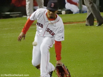 Mookie Betts asked for a few throws down low as he warmed up between innings.