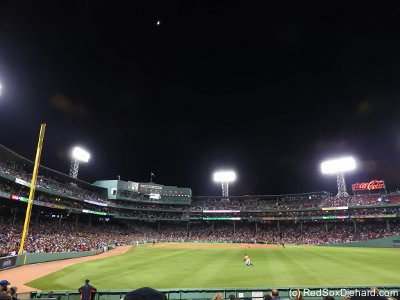 The moon rises over Fenway as Houston right fielder George Springer chases after yet another Boston moonshot.