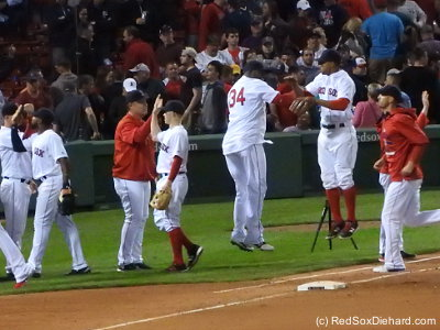 Big Papi and Xander Bogaerts jumped to congratulate each other during the post-game celebration.